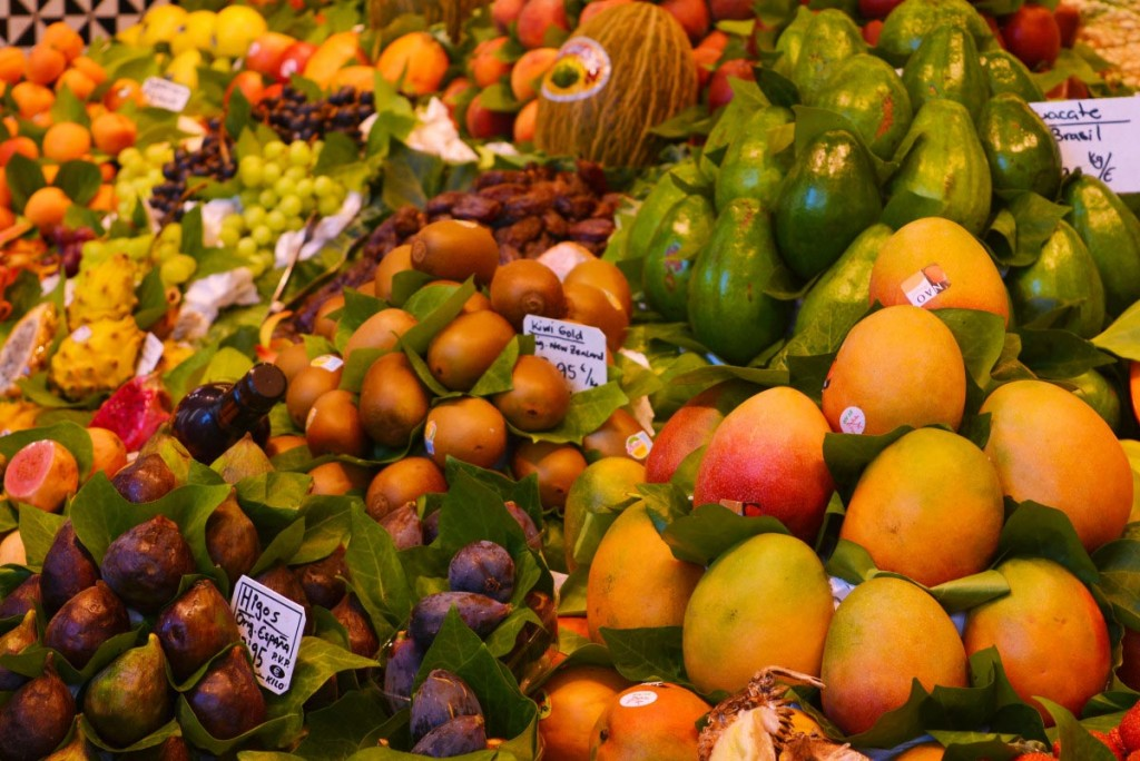 A variety of fruits in the food market La Boqueria, Barcelona for tourists