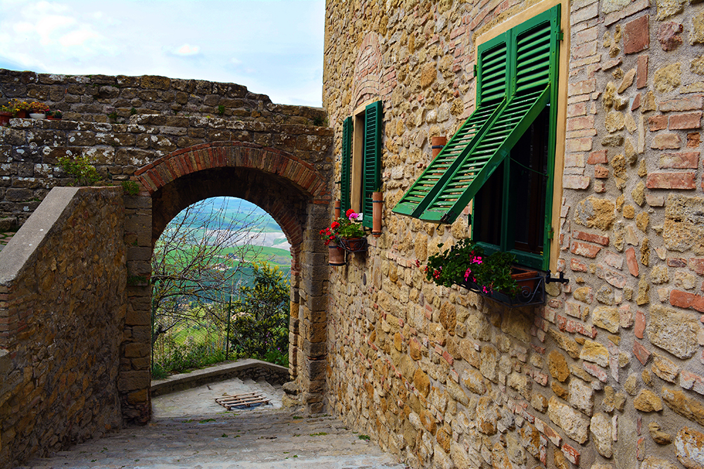 Romantic houses in Volterra, Tuscany outside of the old city walls, overlooking the valley.